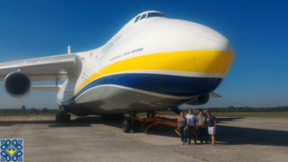 Antonov Plant Tour | Aviation Enthusiasts from Germany, Estonia and Canada in front of Antonov AN-124 Ruslan