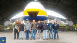 Antonov Plant Tour | Aviation Enthusiasts from USA, Netherlands, China, Ireland, Czech Republic in front of Antonov AN-124 Ruslan