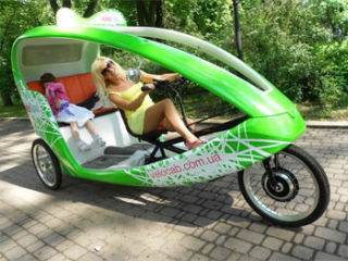 On streets of Kiev appeared new ecological transport | Order electric bicycle taxi by brand VeloTaxi